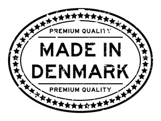Grunge black premium quality made in Denmark oval rubber seal stamp on white background