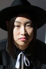 Stylish Asian woman looking at camera