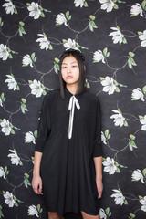 Pretty Asian woman in black dress