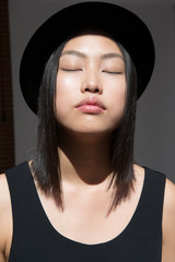 Stylish pretty Asian woman in hat