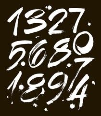set of calligraphic acrylic or ink numbers. ABC for your design, brush lettering on a black background with blots
