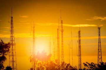 Telecommunication tower Antenna at sunset.