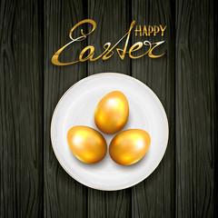 Golden Easter eggs on plate