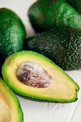 Group of organic fresh ripe and unripe avocados isolated on white background