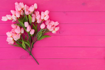 Bouquet of fresh pink flowers on wood