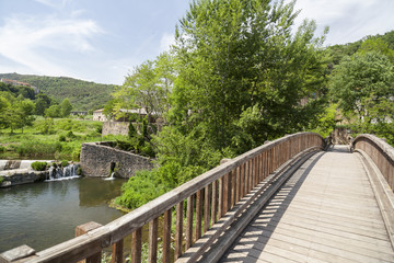 Landscape with wooden bridge in Garrotxa region,Castellfollit de la Roca,Catalonia,Spain.