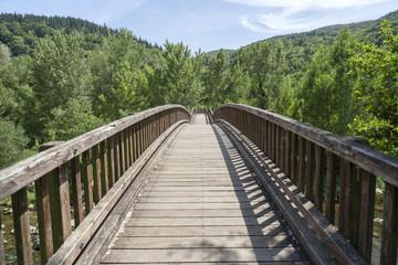 Landscape with wooden bridge in Garrotxa region,Castellfollit de la Roca,Catalonia,Spain.