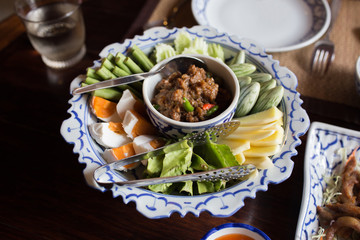 Thai food name Naam Phrik Lohng Reuua (Boat Embarking Chili Relish) is relish of fermented shrimp paste sauce with sweet pork condiment, crispy deep fried fluffy fish, salted eggs and vegetables.