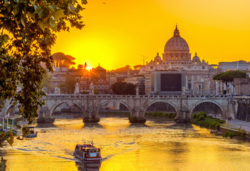Sunset view of Basilica St Peter, bridge Sant Angelo and river Tiber in Rome. Italy