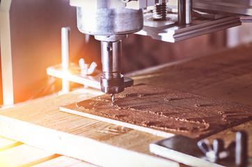 cnc milling machine in work wood