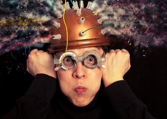 Man crazy inventor wearing a helmet brain research