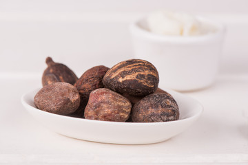 Shea butter nuts on a white table