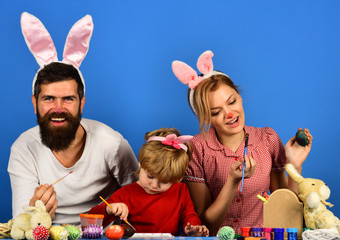Man, woman and kid wearing bunny ears. Holiday spirit