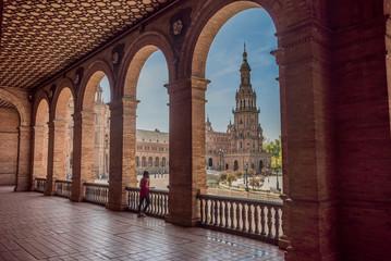 Young woman latina tourist visiting Plaza España in Seville