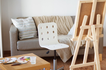 wooden easel and chair at home room or art studio