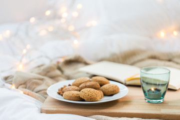 Fototapete - oatmeal cookies and candle in holder at home