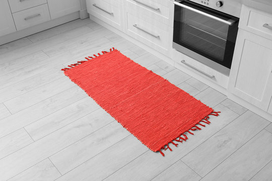 Colorful rug on floor in kitchen