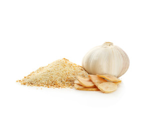 Granulated dried garlic and flakes on white background