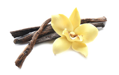 Foto auf AluDibond Aromastoffe Vanilla sticks and flower on white background