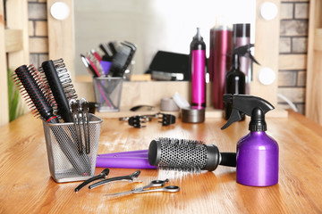 Professional hairdresser set on table in salon