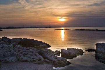 Beautiful sunset in yellow as background. Azerbaijan nature . The sunset, the sea and the clouds. Caspian Sea. Azerbaijan Baku