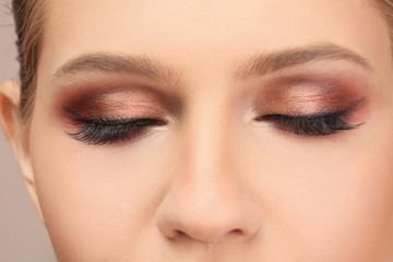 Woman with beautiful makeup, closeup. Professional visage artist work