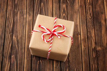 Parcel gift box on wooden background