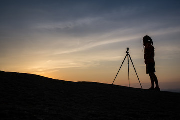 Silhouette of photographer taking photo in sunset