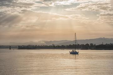 Boat sailing at dawn along the Lima river