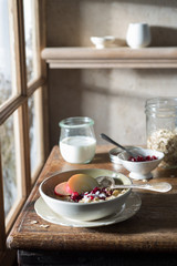 Breakfast Table with Muesli, Milk and Fruit