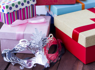 Carnival mask on a background of the gifts