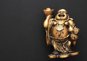 Golden Buddha on a black background