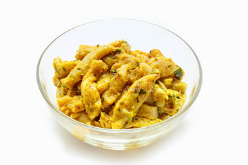 Indian chicken curry on bowl ready to cook. Marinated Chicken in chili, turmeric and different spices, isolated on white background.