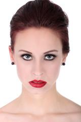 Hübsche Frau mit tollem Make Up blickt