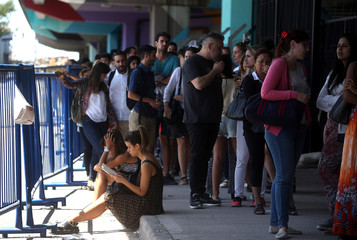 People line up during a campaign of vaccination against yellow fever, dengue, chikungunya and zika in Buenos Aires