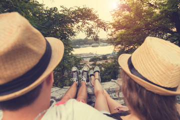 Couple in love enjoying the view. Focus on shoes. Love concept.