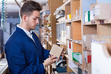 Male worker choosing items for work