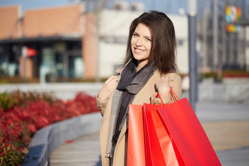 young woman doing shopping with paper bags