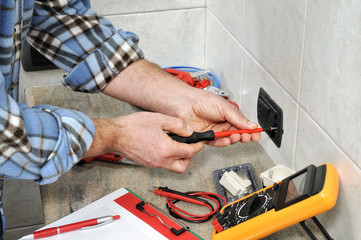 Electrician technician at work on a residential electric system.