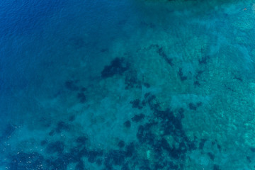 Aerial view on turquoise waves, water surface texture.