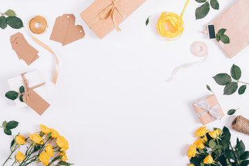 Top view of festive decorations of yellow roses and gift boxes