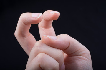Two fingers in an a gesture