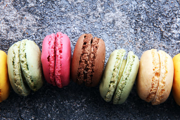 Sweet and colourful french macaroons or macaron on grey background, Dessert