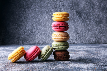Wall Mural - Sweet and colourful french macaroons or macaron on grey background, Dessert