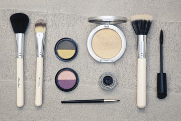 Make up brushes and cosmetics, still life.