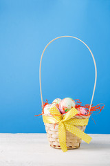 Image of basket with colorful eggs