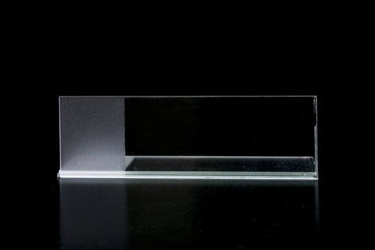 Glass microscope slides, on a contrastant reflective black background