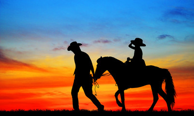 silhouette, girl riding a horse on the sunrise.