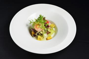 Fresh avocado and shrimps salad on white plate
