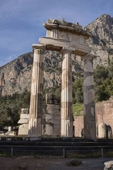 Ruins of Athina Pronaia temple in Ancient Delphi archeological site in Fokida, Greece